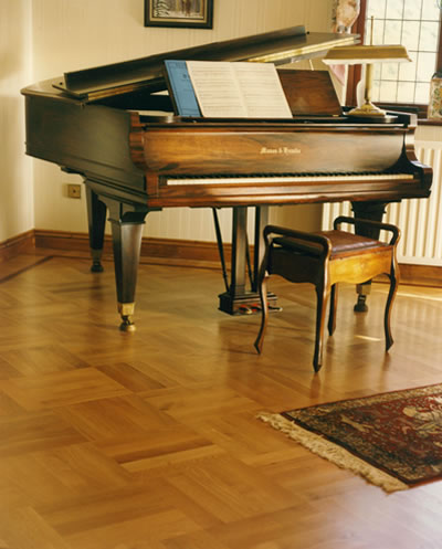 how to move piano on hardwood floor